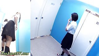 Bathroom cams film cute Japanese chicks pissing in toilets