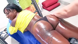 Gogo Fukme is a sporty black lady with big nice ass. She shows off her oiled bubble butt at the gym with her tight black panties on. White man curiously touches her chocolate ass
