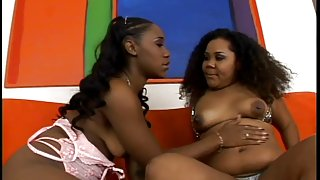 Marvelous dark lesbian babes with thick booties oil themselves and fuck with toys