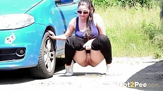 Big ass girl goes pee in a parking lot