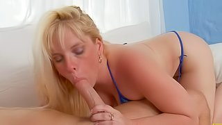 Cameron Keys is a blonde mom in tiny blue bikini. Hot bodied woman turns him on. Shes his buddys sex starved mom and he gives her a helping cock. He bangs her jugs and pink pussy on the couch