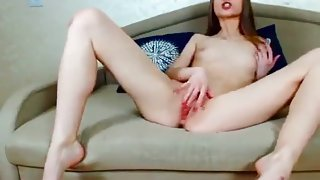 Pretty Roxxane masturbates and plays with a rubber dildo
