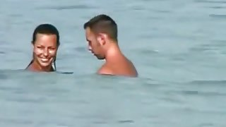 Voyeur tapes a girl sucking her bf's cock on a nude beach